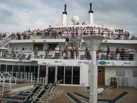 Passengers on deck as the QM2 sailed out of Southampton